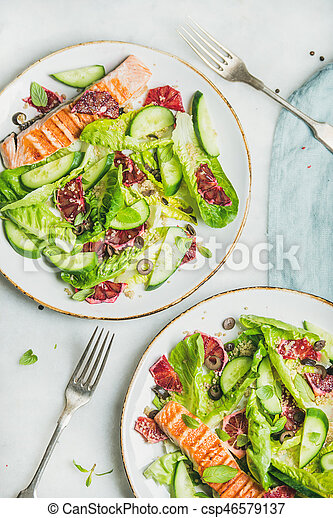 Healthy salad with grilled salmon, orange, olives, cucumber and quinoa - csp46579137