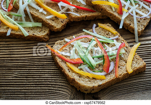 Healthy Sandwiches With Fresh Vegetables Breakfast Toasts On Wooden Cutting Board Balanced Breakfast Canstock
