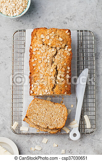 Healthy vegan oat and coconut loaf bread, cake on a cooling rack Top view - csp37030651