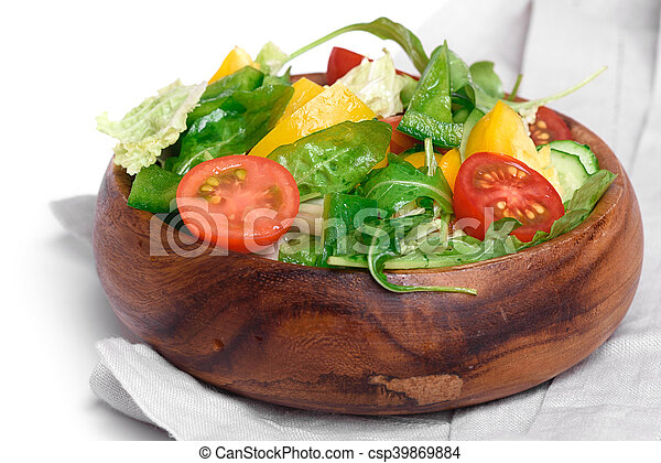 Healthy Vegetable salad in a wooden bowl - csp39869884