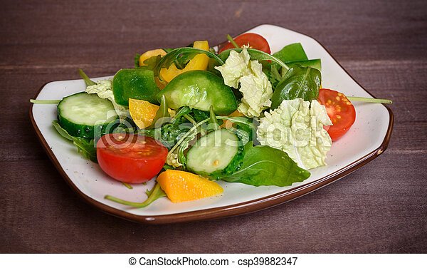 Healthy vegetable salad on a plate - csp39882347