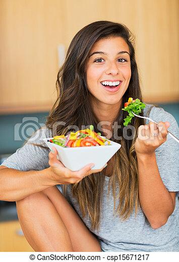 Healthy woman eating salad - csp15671217