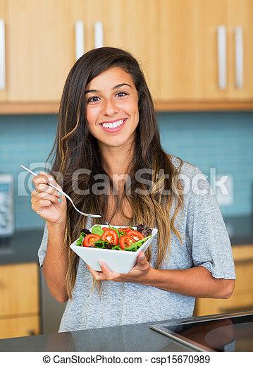 Healthy woman eating salad - csp15670989