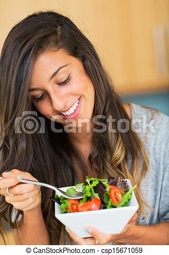 Healthy woman eating salad - csp15671059
