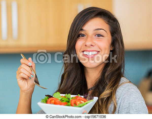 Healthy woman eating salad - csp15671036