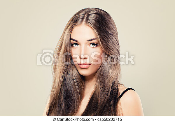 Healthy Woman with Perfect Skin and Long Brown Hair. Young Beauty - csp58202715
