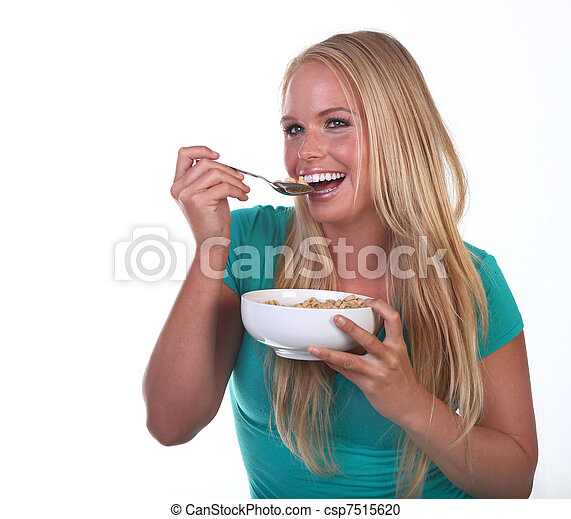 Healthy Young Woman Eating Nutritious Food - csp7515620