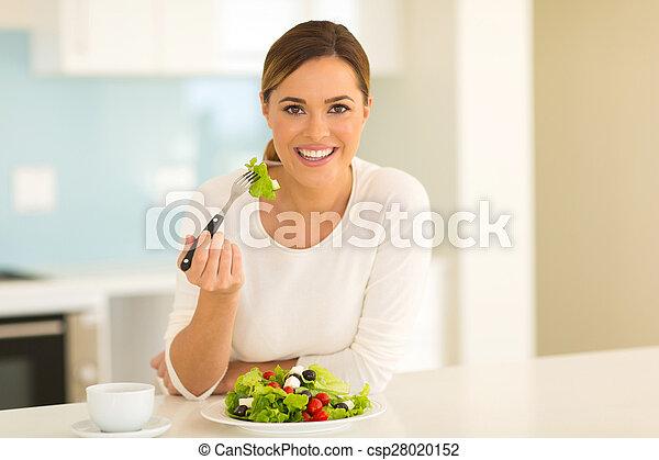 healthy young woman eating salad - csp28020152