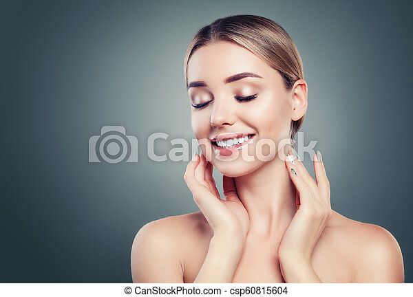 Healthy young woman smiling on background with copy space - csp60815604
