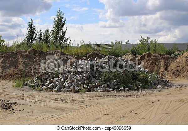 Heap of cobblestones in front of sky - csp43096659
