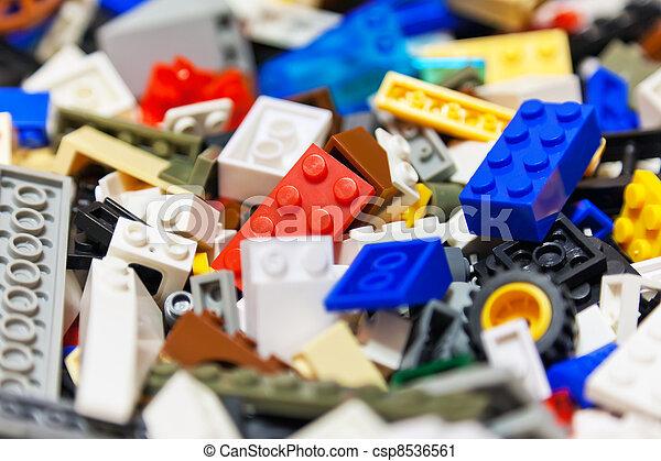 Heap of color plastic toy bricks - csp8536561