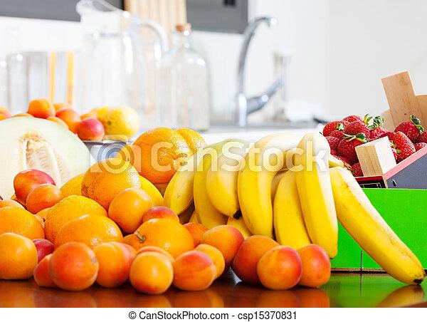 Heap of fresh fruits at table - csp15370831