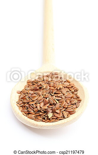 Heap of linseed with wooden spoon on white background - csp21197479