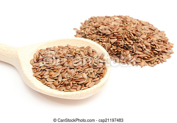 Heap of linseed with wooden spoon on white background - csp21197483