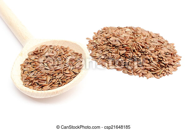 Heap of linseed with wooden spoon on white background - csp21648185