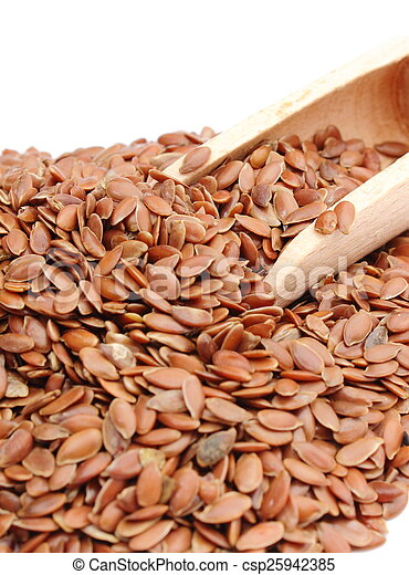 Heap of linseed with wooden spoon on white background - csp25942385