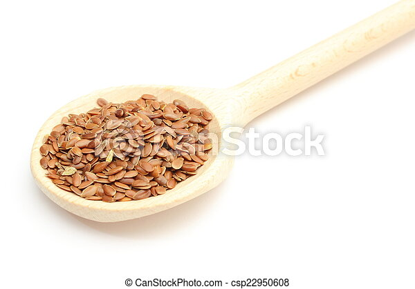Heap of linseed with wooden spoon on white background - csp22950608