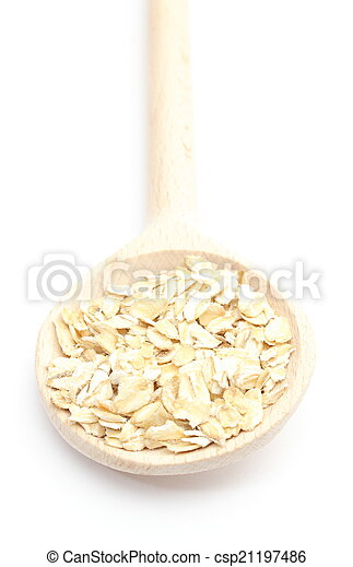 Heap of oatmeal with wooden spoon on white background - csp21197486