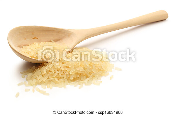 Heap of rice with wooden spoon - csp16834988