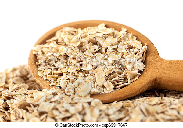 Heap of rolled oats with wooden spoon on white - csp63317667