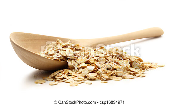 Heap of rolled oats with wooden spoon - csp16834971
