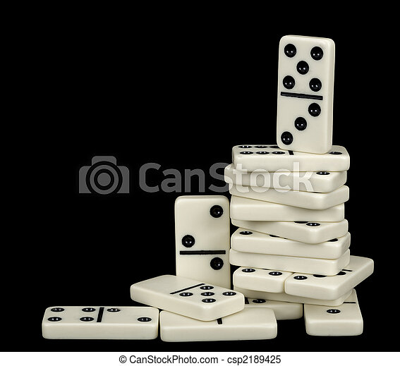Heap of white dominoes isolated on black - csp2189425