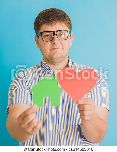 heart and a small house in the hands of - csp14503610