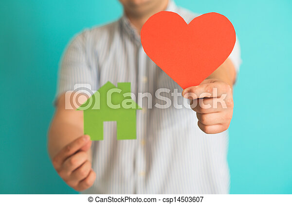 heart and a small house in the hands of - csp14503607