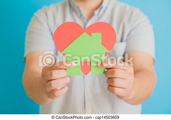 heart and a small house in the hands of - csp14503609