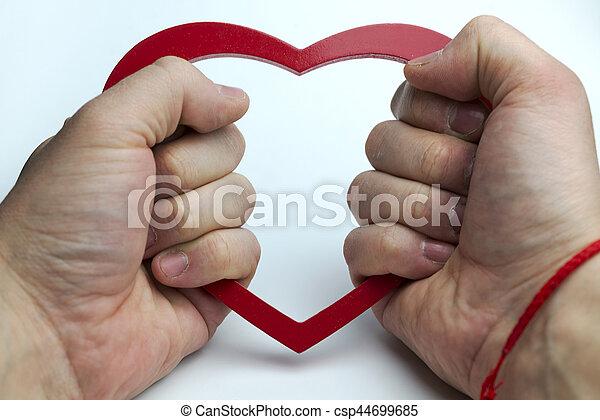 Heart in hand. - csp44699685