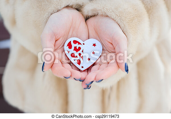 heart in the hands of a girl - csp29119473