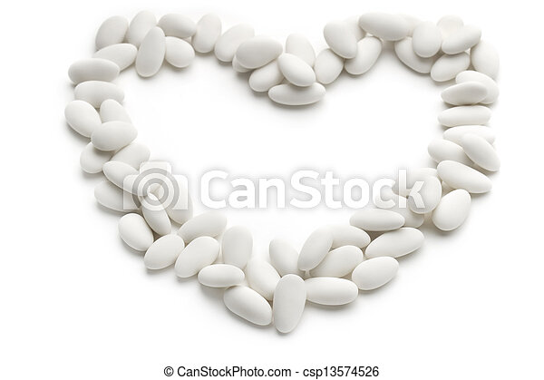 heart of sugared almonds on white background - csp13574526