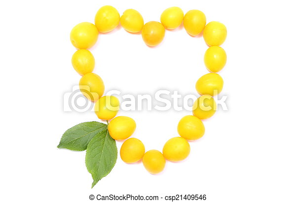 Heart of yellow mirabelle on white background - csp21409546