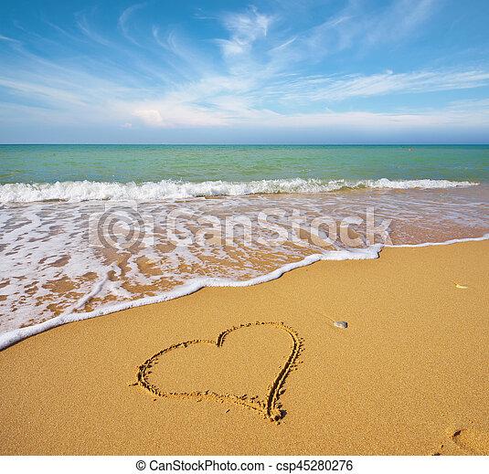 Heart on the sand of a beach. - csp45280276