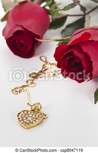 Heart pendant with diamond and red rose on white background stock heart pendant with diamond and red rose on white background stock photo mozeypictures Image collections