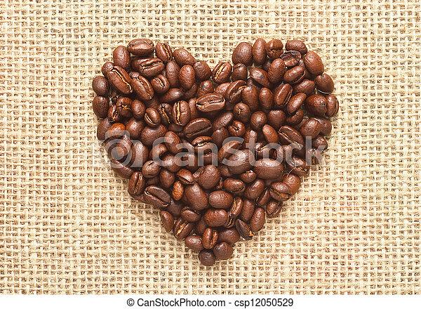heart shape coffee beans on sacking - csp12050529