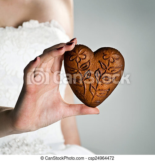 heart shape in the hands of a young woman - csp24964472