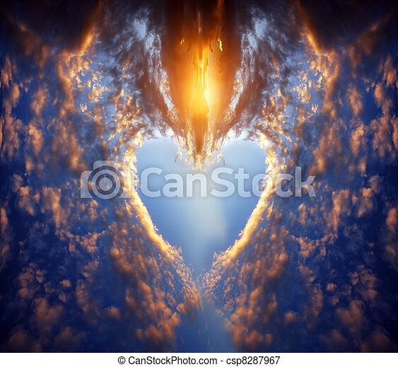 Heart shape on sunset sky - csp8287967