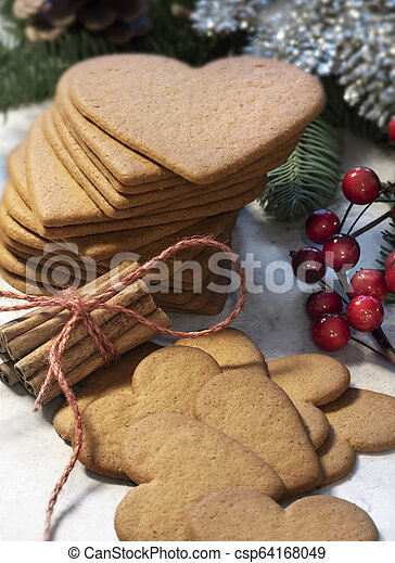 Heart shaped gingerbread cookie - csp64168049