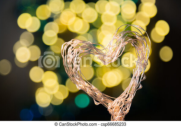 Heart shaped holiday blurred bokeh background. Valentine backgro - csp66685233