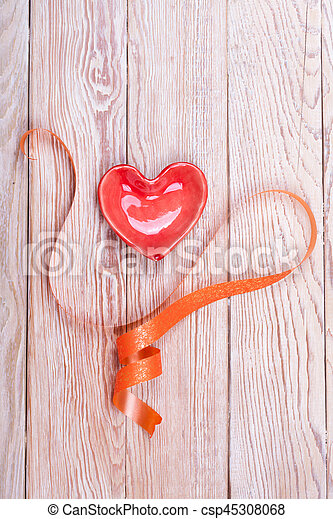 Heart shaped valentine gift with ribbon - csp45308068