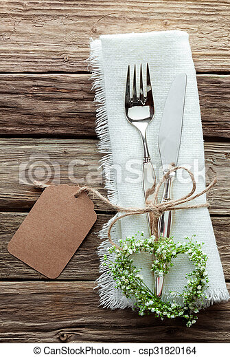 Heart Shaped Wreath and Wedding Cutlery on White Napkin - csp31820164