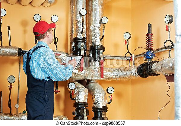 heating engineer repairman in boiler room - csp9888557