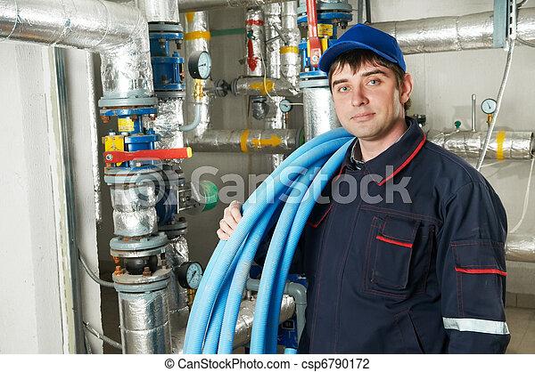heating engineer repairman in boiler room - csp6790172