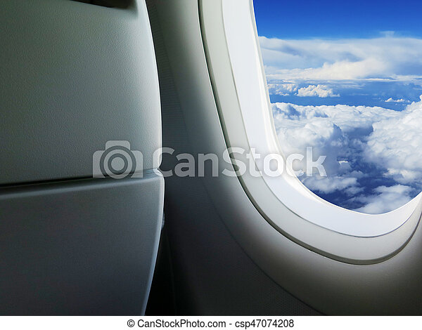 heavenly sky seen through the windows of an airplane - csp47074208