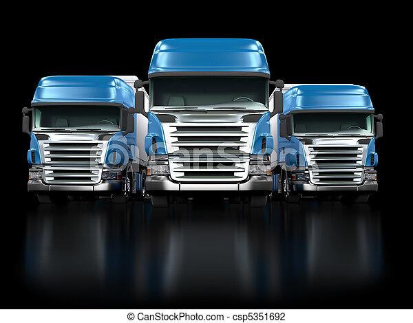 Heavy blue trucks isolated on black - csp5351692