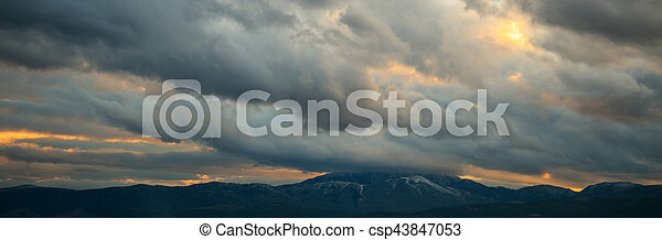 Heavy clouds over mountains - csp43847053