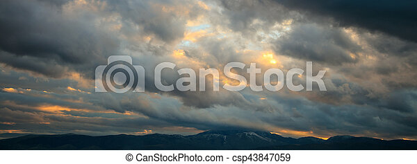 Heavy clouds over mountains - csp43847059