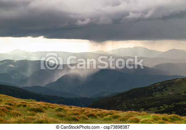 Heavy rain and gale over the mountains. - csp73898387