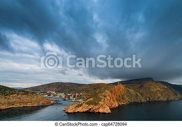 Heavy rain clouds over the bay, sea landscape - csp64728094